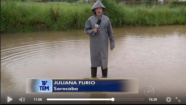 TV TEM journalist going live in a flood with Dejero